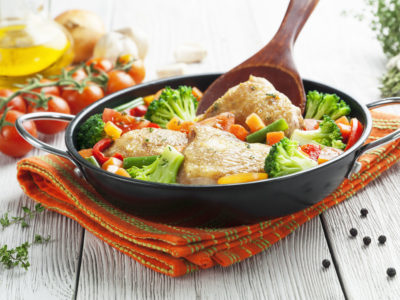 Fried chicken with vegetables in the  pan