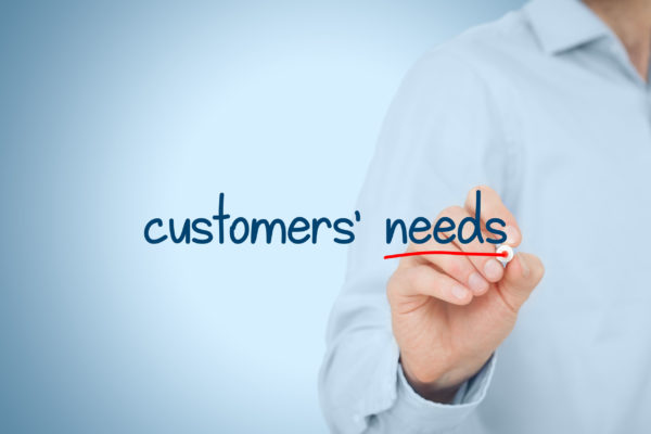 40655999 - customers needs concept. marketing specialist think about customer needs, represented by text written on virtual board.
